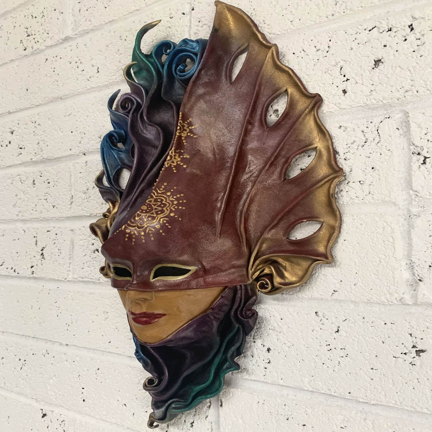 Venetian style moulded leather wall mask