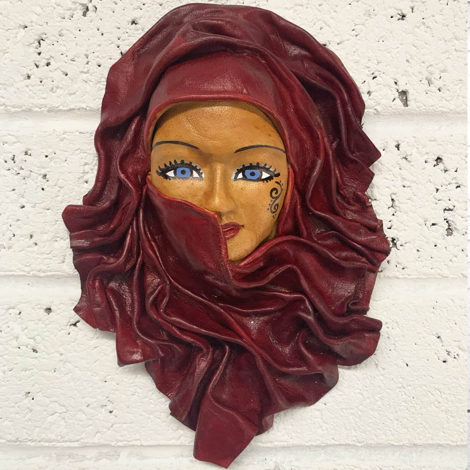 Middle Eastern woman moulded leather wall mask